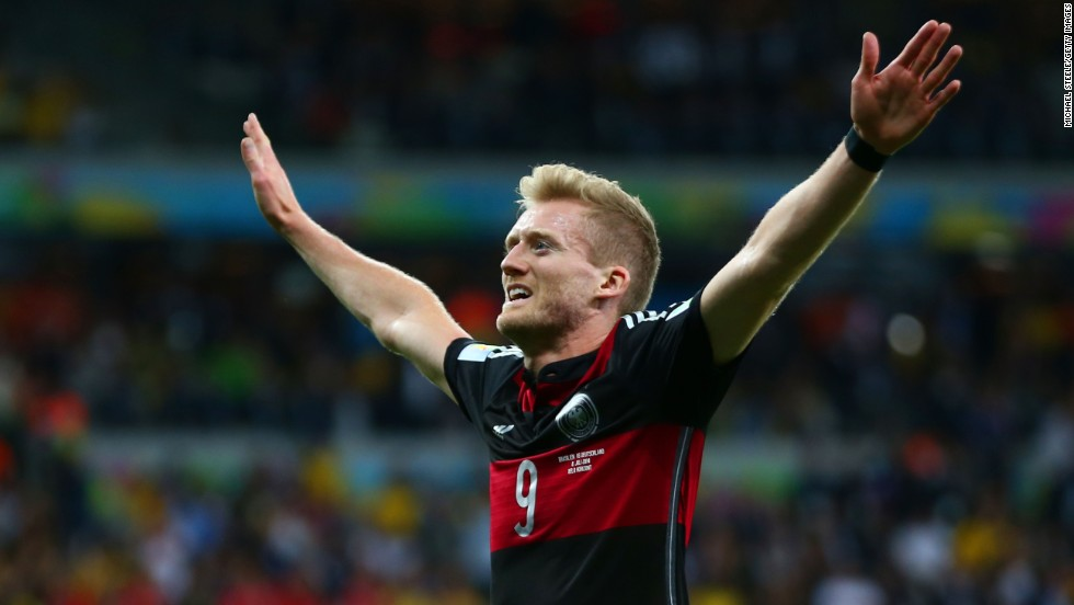 Andre Schuerrle of Germany celebrates scoring his team's seventh goal. It was his second goal of the game.