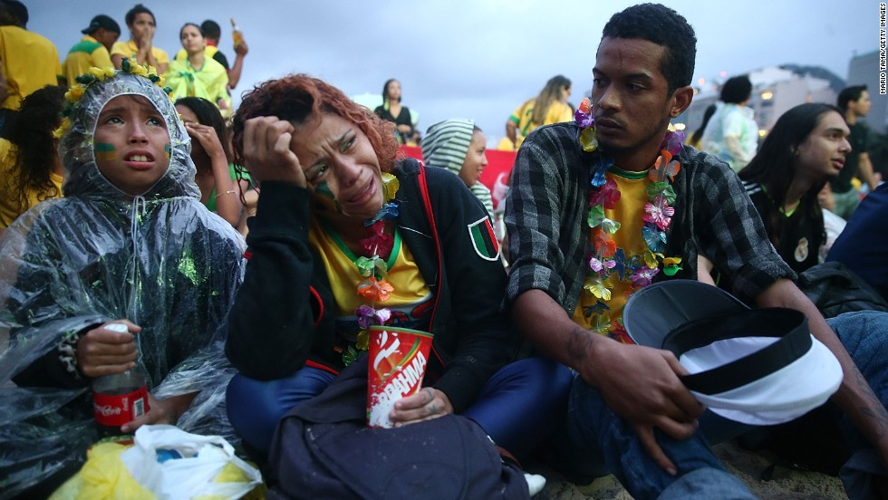 Brazil fans in Rio de Janeiro appear devastated as they watch a live telecast of the match.