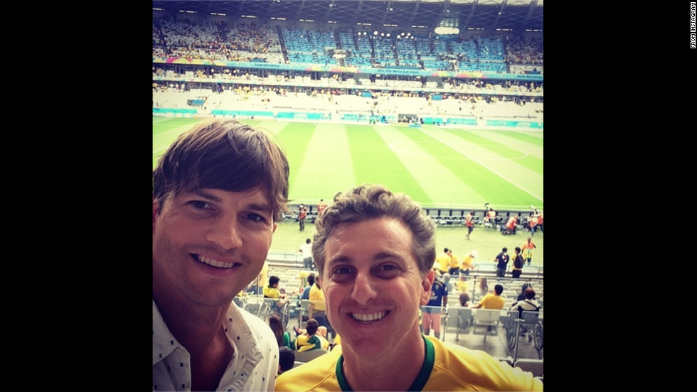 "Actor Ashton Kutcher, left, and Brazilian TV presenter Luciano Huck <a href=""http://instagram.com/p/qM3JbonJ87/"" target=""_blank"">take in the World Cup soccer match</a> between Brazil and Germany on Tuesday, July 8. Germany <a href=""http://www.cnn.com/2014/07/08/football/gallery/world-cup-best-0708/index.html"">trounced Brazil</a> 7-1 to advance to the tournament final."