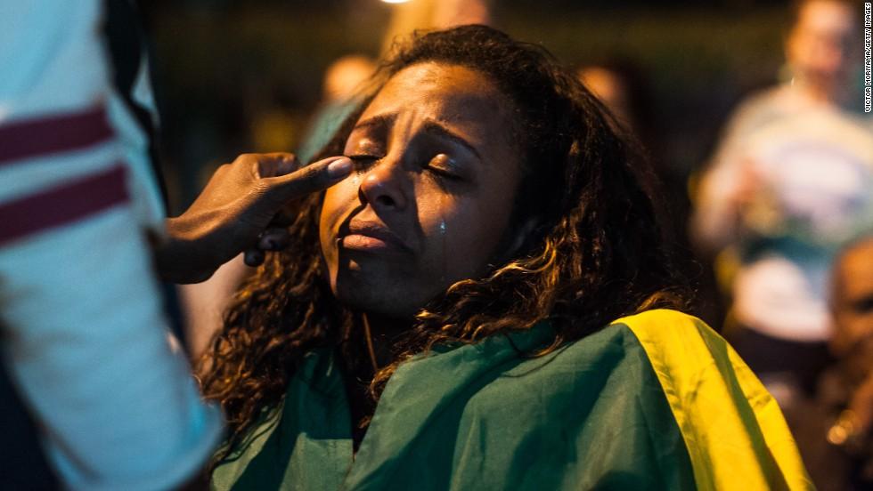 A fan wipes another fan's tears in the streets of Sao Paulo, Brazil.