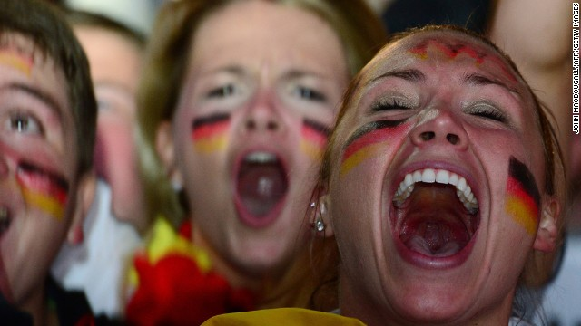 Germany fans celebrate Germany's seventh goal during the FIFA World Cup 2014 semi final football match between Brazil and Germany during a public viewing at the Brandenburg Gate in Berlin on July 8, 2014.  AFP PHOTO / JOHN MACDOUGALL        (Photo credit should read )