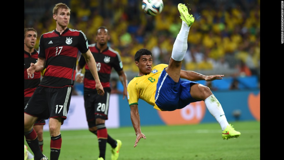 Brazilian midfielder Paulinho attempts an overhead kick.