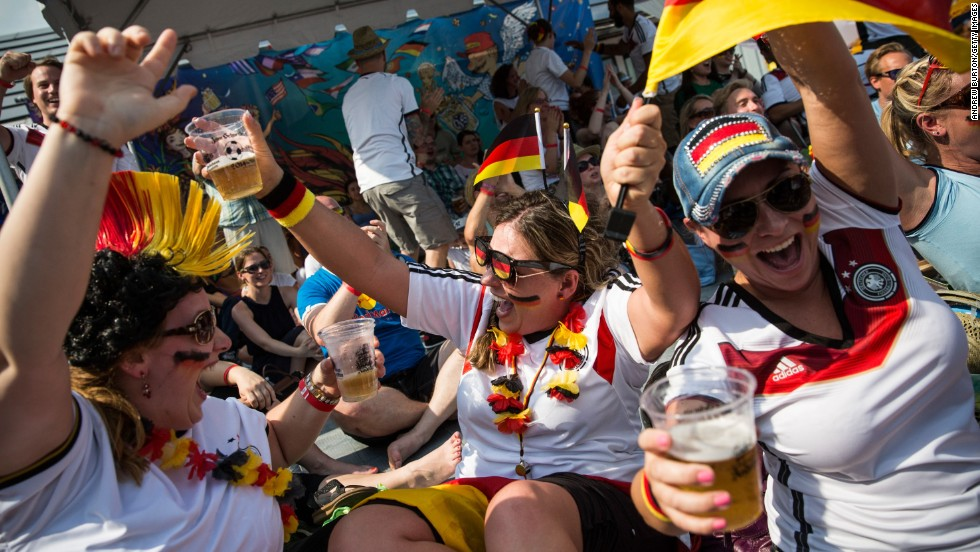From left, Oona Hodos, Nathalie Dorner and Natascha Cozby celebrate in New York City after a German goal on July 8. Germany defeated Brazil 7-1 to advance to the final.