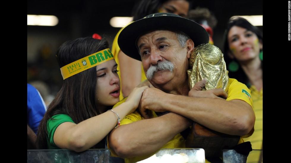 A Brazil fan cries after the match in Belo Horizonte.