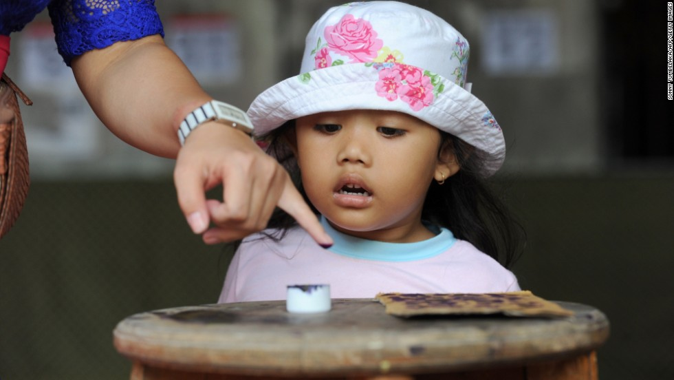 A Balinese woman inks her finger after voting in the presidential election in Bali on July 9.