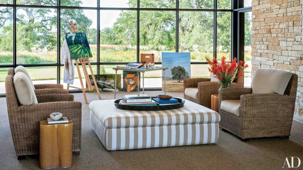 "Breezeway: Mr. Bush sometimes paints at an easel in the enclosed breezeway, where the windows are replaced with screens in warm weather; the ottoman and the cushions on the sea-grass chairs are covered in Sunbrella fabrics. <a href=""http://www.architecturaldigest.com/celebrity-homes/2014/laura-and-george-w-bush-prairie-chapel-ranch-texas-article?mbid=synd_cnn"" target=""_blank"">See more at ArchDigest.com</a>"