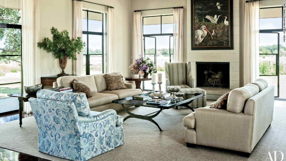 "Living Room: Mounted on the living area's limestone chimney breast is an Adrian Martinez painting, which over looks sofas clad in a Glant fabric, a club chair upholstered in a Groves Bros. print, and a cocktail table designed by Mrs. Bush; the windows are curtained in a Calvin Fabrics linen, and the ammonite fossils displayed atop the pedestal table were found on the property. <a href=""http://www.architecturaldigest.com/celebrity-homes/2014/laura-and-george-w-bush-prairie-chapel-ranch-texas-article?mbid=synd_cnn "" target=""_blank"">See more at ArchDigest.com</a>"