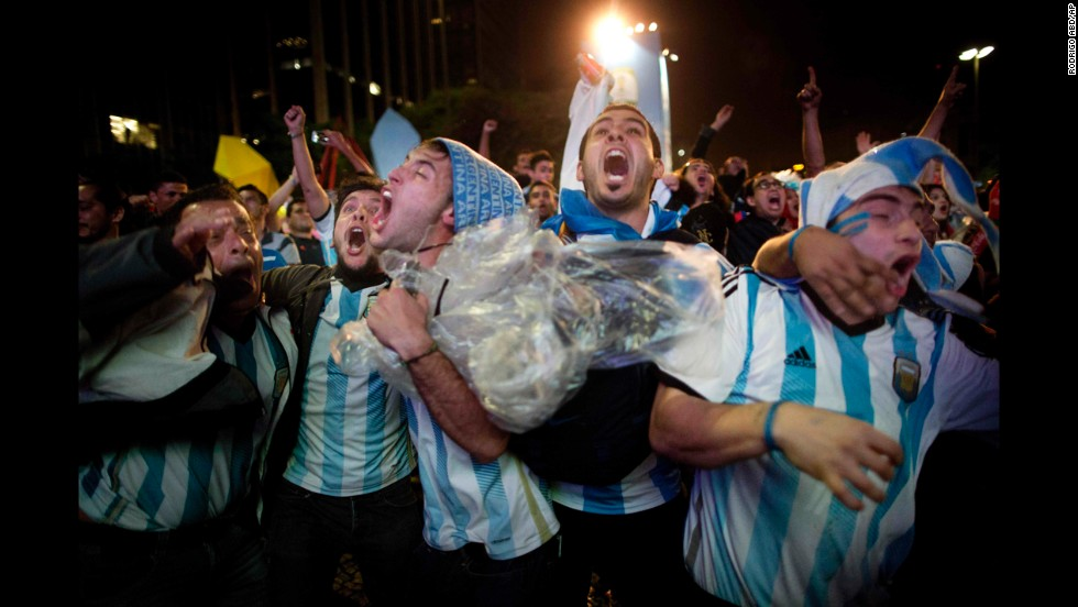 Fans of Argentina celebrate after their team defeated the Netherlands in Sao Paulo, Brazil.