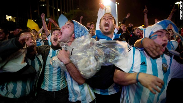 Fans of the Argentina national soccer team celebrate after their team defeated The Netherlands in the semifinals a match against The Netherlands, at the FIFA Fan Fest, during the 2014 soccer World Cup in Sao Paulo, Brazil, Wednesday, July 9, 2014. Argentina made it to the World Cup final with a 4-2 shootout win over the Netherlands after the game finished in a 0-0 stalemate. (AP Photo/Rodrigo Abd)