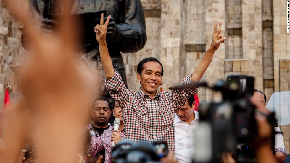 Indonesian presidential candidate Joko Widodo greets his supporters as he declares victory in the election. But official election results are expected July 22.