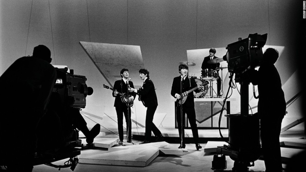 "The Beatles perform on ""The Ed Sullivan Show"" in 1964."