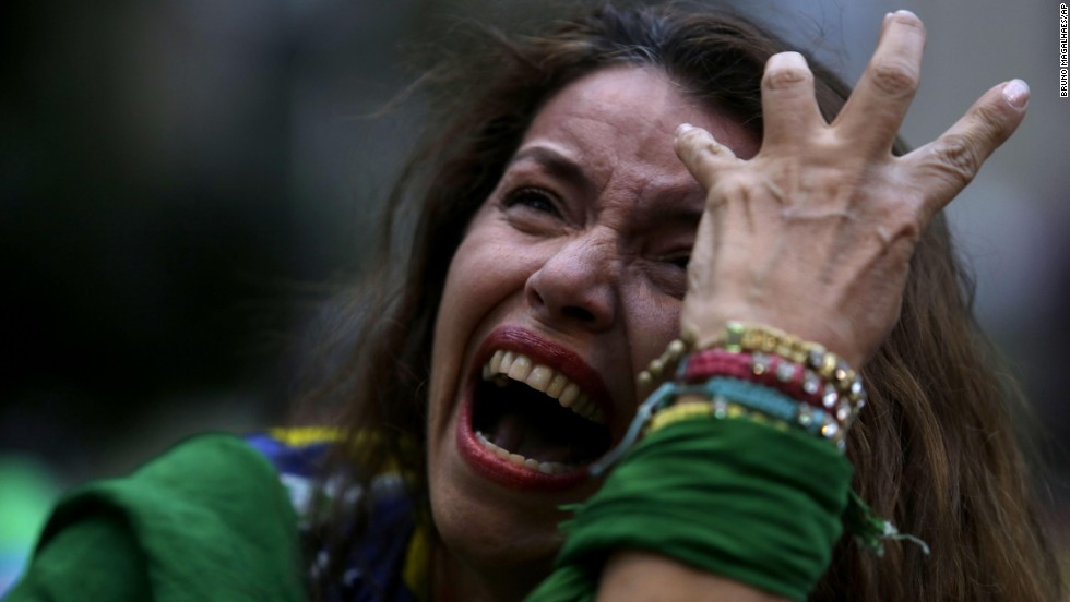 "A Brazil soccer fan cries as she watches a live telecast of the <a href=""http://www.cnn.com/2014/07/08/football/gallery/world-cup-best-0708/index.html"">World Cup semifinal match</a> between Brazil and Germany on Tuesday, July 8. Many fans in Brazil were <a href=""http://www.cnn.com/2014/07/08/worldsport/gallery/brazil-fans/index.html"">overcome with emotion</a> after the national team lost 7-1 in Belo Horizonte, Brazil."