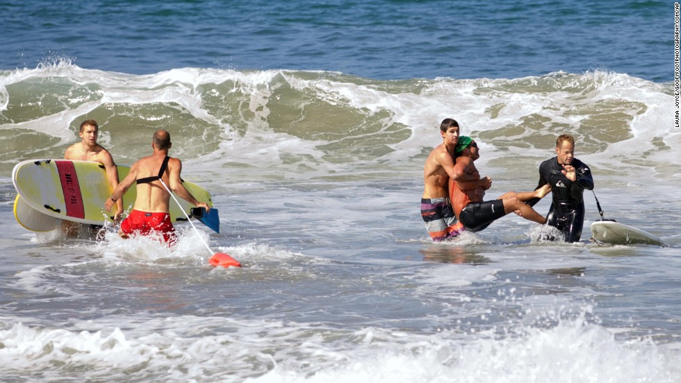 "Two men carry Steven Robles after Robles was <a href=""http://www.cnn.com/2014/07/07/us/california-shark-attack/index.html"">attacked by a great white shark</a> Saturday, July 5, near Manhattan Beach, California. The 7-foot-long shark became agitated by a fisherman's hook and apparently took out its frustration on Robles, who was swimming nearby. ""It did a sharp left turn and then it lunged right at me,"" said Robles, a long-distance swimmer. He is recovering from his wounds, but he said he might never swim in the open water again."