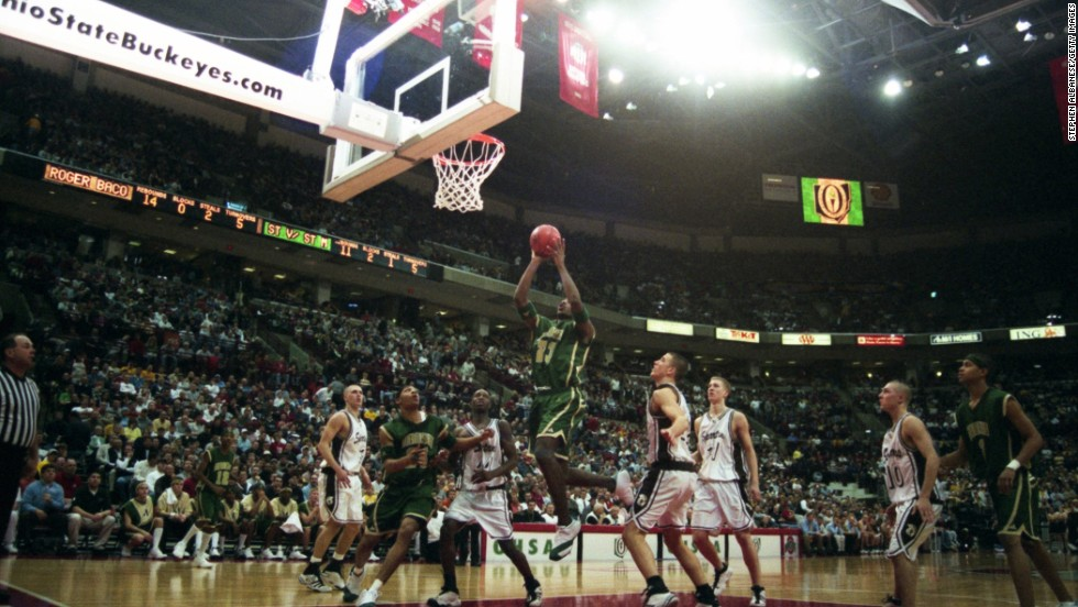 James drives to the hoop in 2002 as he plays for St. Vincent-St. Mary High School in Akron, Ohio. James was already starting to become a household name in high school, and ESPN was even airing some of his games.