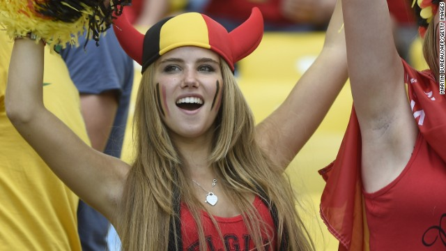Axelle Despiegelaere, a Belgium supporter cheers with her friend as they wait for the start of the Group H football match between Belgium and Russia at the Maracana Stadium in Rio de Janeiro during the 2014 FIFA World Cup on June 22, 2014. AFP PHOTO / MARTIN BUREAU (Photo credit should read MARTIN BUREAU/AFP/Getty Images)