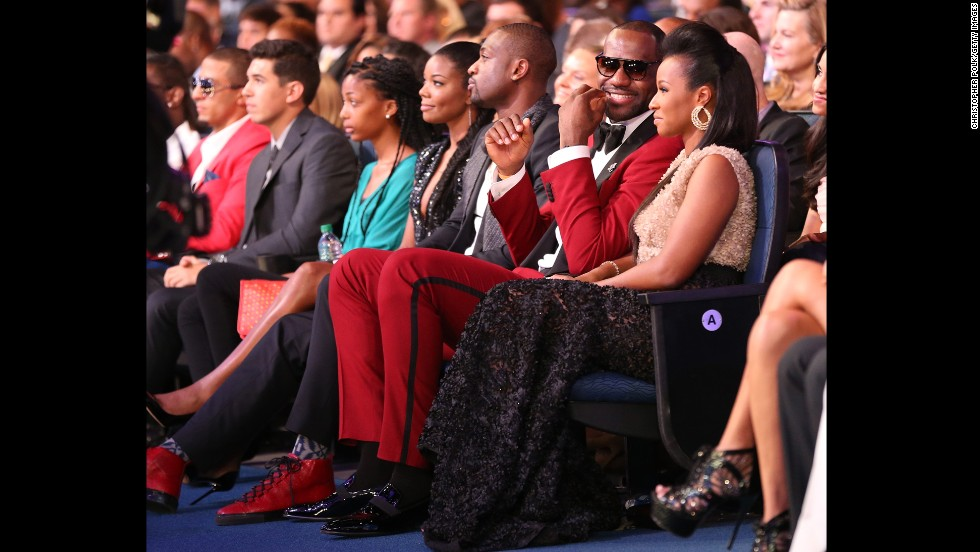 James attends the 2013 ESPY Awards in Los Angeles with his future wife, Savannah Brinson. They have two children.