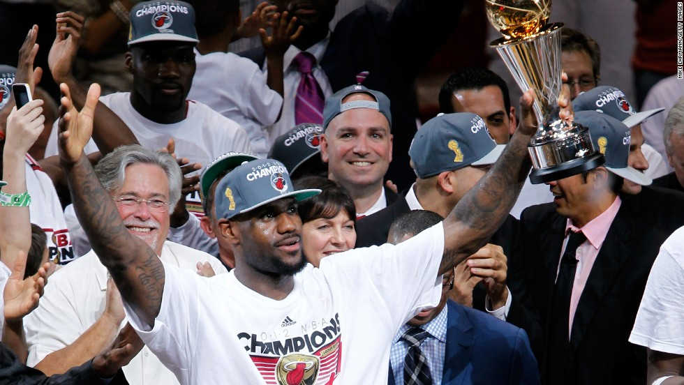 James celebrates with the NBA Finals Most Valuable Player trophy after the Heat defeated the Oklahoma City Thunder to win the NBA title in June 2012.