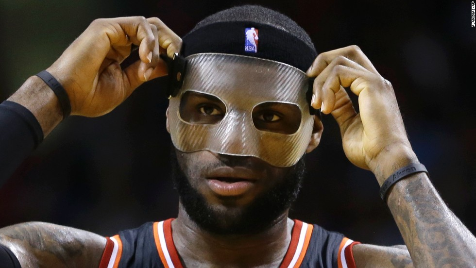 James adjusts a protective mask he wore in March to protect a broken nose.