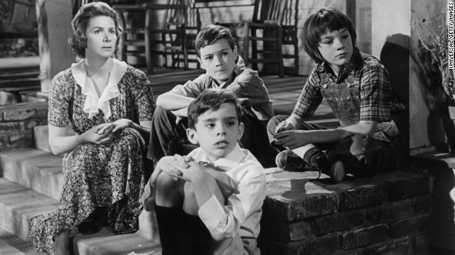 "Rosemary Murphy, left, sits with Mary Badham, top right, and other children in a scene from the film ""To Kill A Mockingbird."""