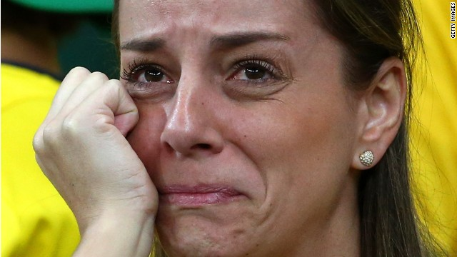 A dejected Brazil fan looks on during the 2014 FIFA World Cup Brazil Semi Final match between Brazil and Germany on July 8, 2014 in Belo Horizonte, Brazil.