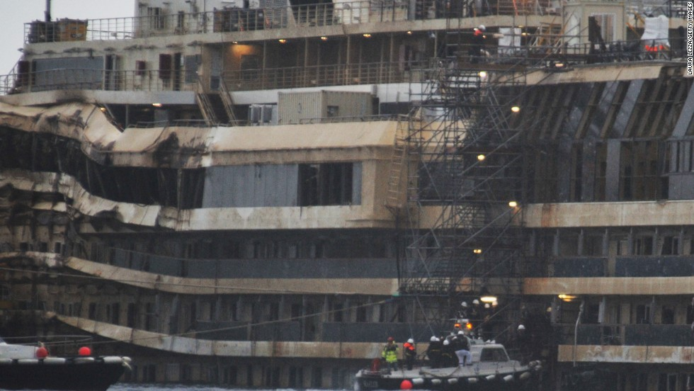 Experts inspect the ship's damage in January. They boarded the vessel to collect new evidence, focusing on the ship's bridge and the onboard elevators.