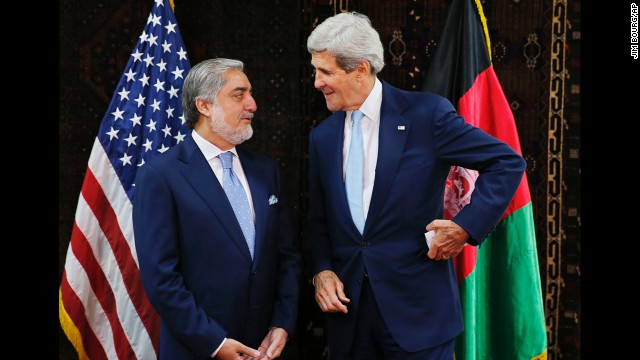 U.S. Secretary of State John Kerry talks with Afghan presidential candidate Abdullah Abdullah, left, at the start of a meeting at the U.S. Embassy in Kabul, July 11, 2014. Kerry sought Friday to broker a deal between Afghanistan's rival presidential candidates as a bitter dispute over last month's runoff election risked spiraling out of control.(AP Photo/Jim Bourg, Pool)