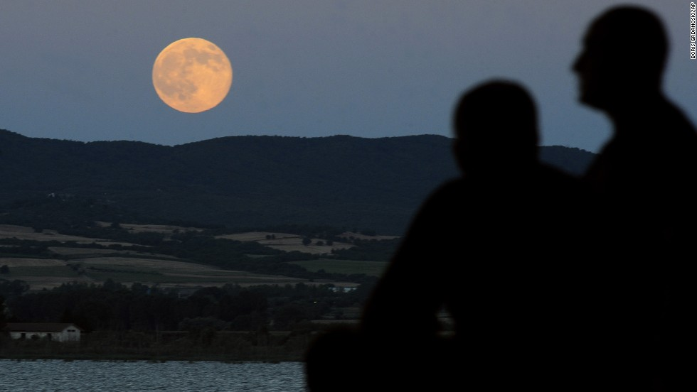 "The moon is seen as it rises above Dojran Lake in southeastern Macedonia. NASA says that there will be three ""supermoons"" this year, occuring on July 12, August 10 and September 9."