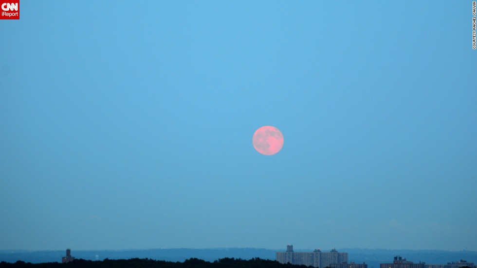 "<a href=""http://ireport.cnn.com/docs/DOC-1152253"">Rachel Cauvin</a> photographed the supermoon hanging over the Bronx, New York, sky. The morning haze seemed to give the moon a red hue."
