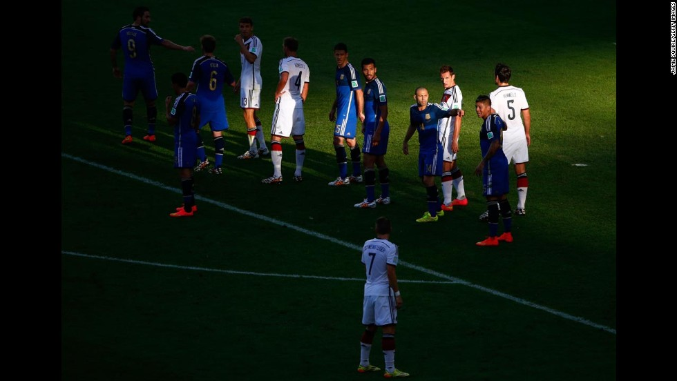 Players take their positions prior to a free kick in the first half.