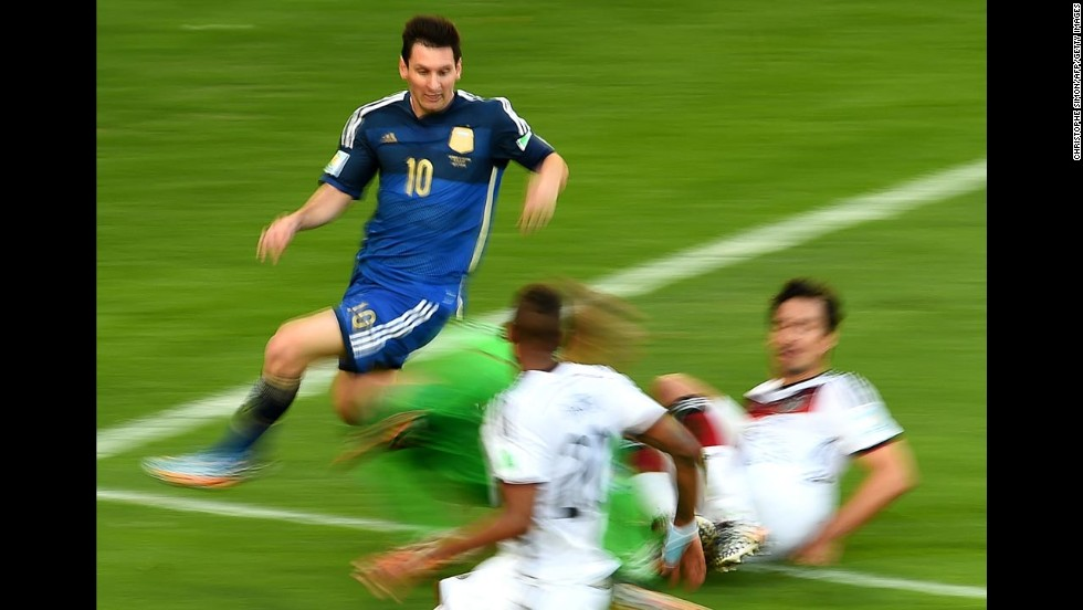 In this photo, shot using a slow shutter speed, Messi makes a run into Germany's penalty box.