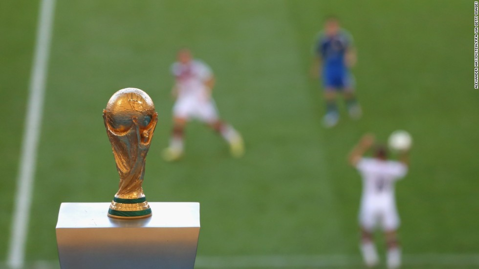 The World Cup trophy is seen in the Maracana Stadium during the match.