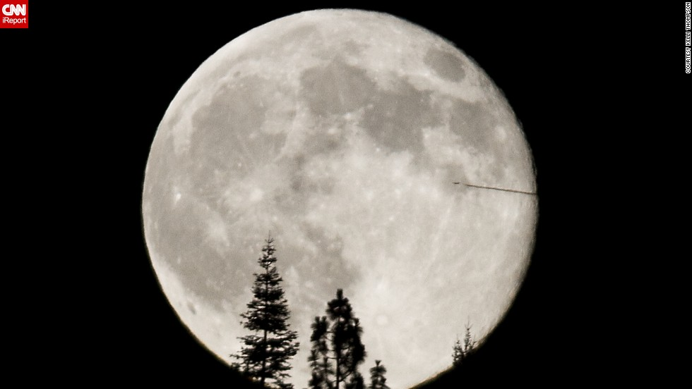 "<a href=""http://ireport.cnn.com/docs/DOC-1152039"">Kelli Thompson</a> photographed the July supermoon from the foothills of the Sierra Nevada Mountains in California. ""The airplane bisecting the supermoon was quite unusual and unexpected,"" she said."