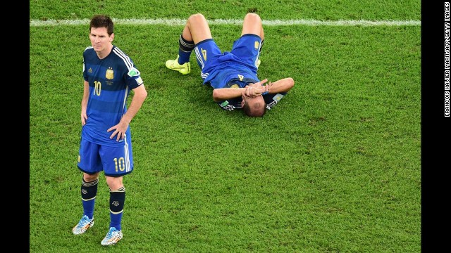 Argentina's Lionel Messi (L) and  Pablo Zabaleta react after losing the 2014 FIFA World Cup final.