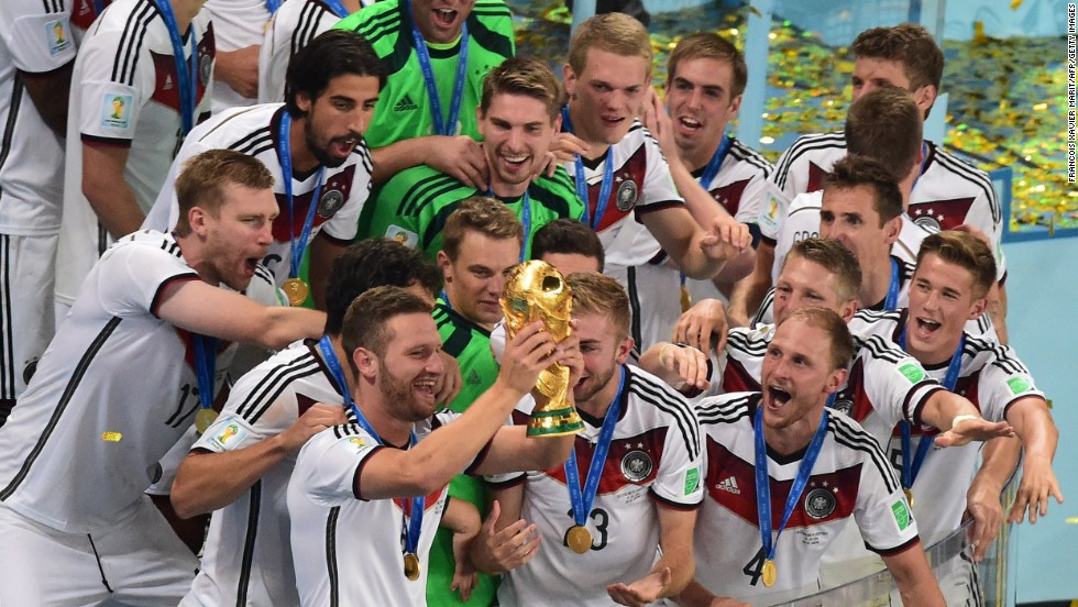 German players celebrate with the World Cup trophy after they defeated Argentina 1-0 in the tournament's final match Sunday, July 13, in Rio de Janeiro. Mario Gotze's goal in extra time was the difference.