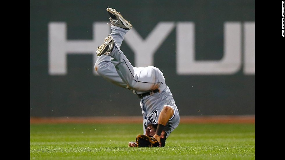 Adam Eaton of the Chicago White Sox flips over as he fails to come up with a catch Tuesday, July 8, in Boston.