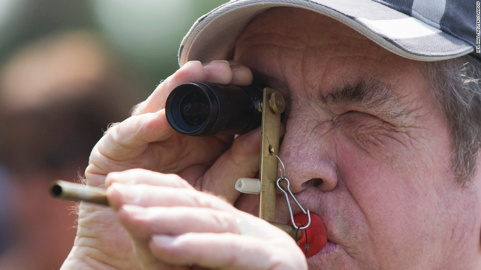 A competitor takes aim Saturday, July 12, during the World Pea Shooting Championships in Witcham, England. The annual competition has been held in the village since 1971, and it attracts participants from all around the world.