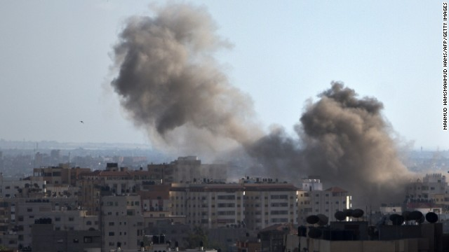 Smoke billows from a building hit by an Israeli air strike in Gaza City, on July 14, 2014. Washington warned its Israeli ally today against any ground invasion of Gaza, as Egyptian officials said the US top diplomat was headed to the region to join efforts to end a week of deadly violence. AFP PHOTO/MAHMUD HAMSMAHMUD HAMS/AFP/Getty Images Credit: 	AFP/Getty Images