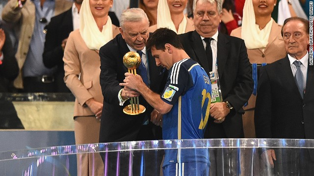 Lionel Messi accepts the Golden Ball award from Jose Maria Marin, President of the Brazilian Football Federation.