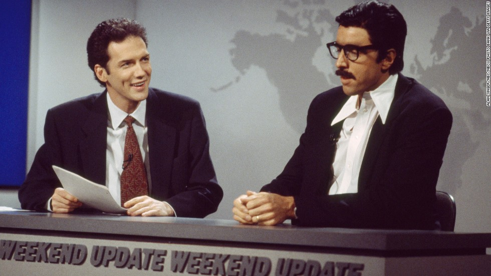 "Norm Macdonald, left, goofs around with Kevin Nealon on ""SNL."" Macdonald hosted Weekend Update from 1994 to 1997 but was ousted after NBC exec Don Ohlmeyer <a href=""http://www.ew.com/ew/article/0,,274941_1,00.html"" target=""_blank"">complained that he wasn't funny. </a>"