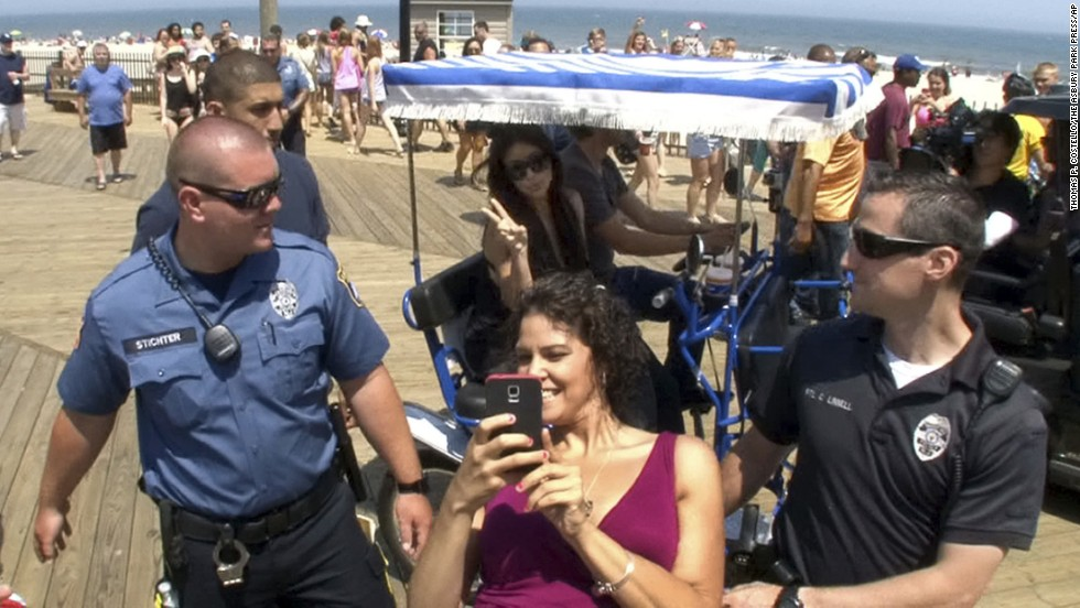 "Sabryna Alvarez takes a selfie as Kim Kardashian rides by Tuesday, July 8, in Seaside Heights, New Jersey. Kardashian's rep <a href=""http://www.app.com/story/entertainment/2014/07/08/kim-kardashian-jersey-girl/12380713/"" target=""_blank"">told the Asbury Park Press</a> that the television personality was taping segments for the series ""Kourtney & Khloe Take the Hamptons."""