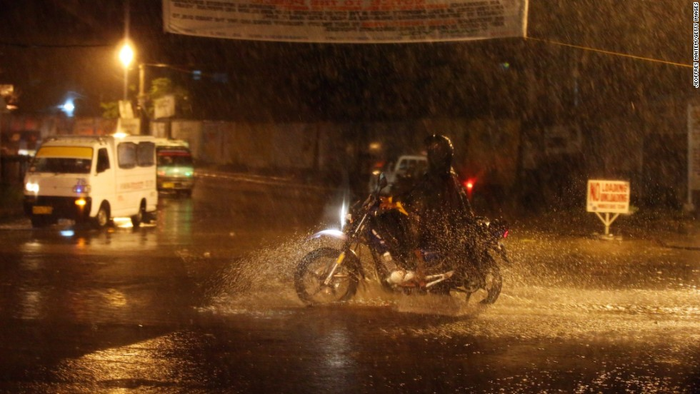 Motorists pass by on a highway during a heavy rain storm on July 15 in Cotabato, Mindanao, Philippines.