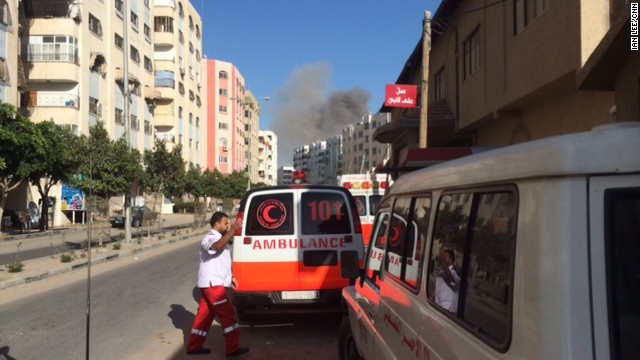 Ambulances scramble to take an explosion in a nearby neighborhood.