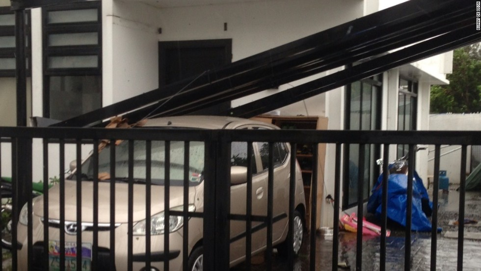 Rammasun causes damage to a resident's carport on July 16.