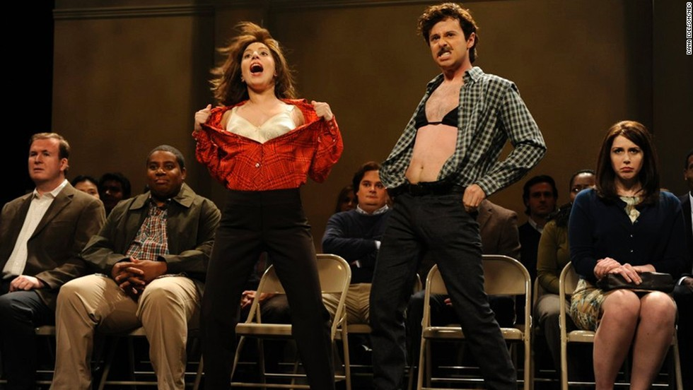 """<a href=""""http://www.deadline.com/2014/07/saturday-night-live-noel-wells-john-milhiser-leaving/"""" target=""""_blank"""">According to Deadline,</a> John Milhiser (in the bra) has also been let go from """"SNL"""" and will not be returning in the fall of 2014. His contract was reportedly not renewed after one season."""