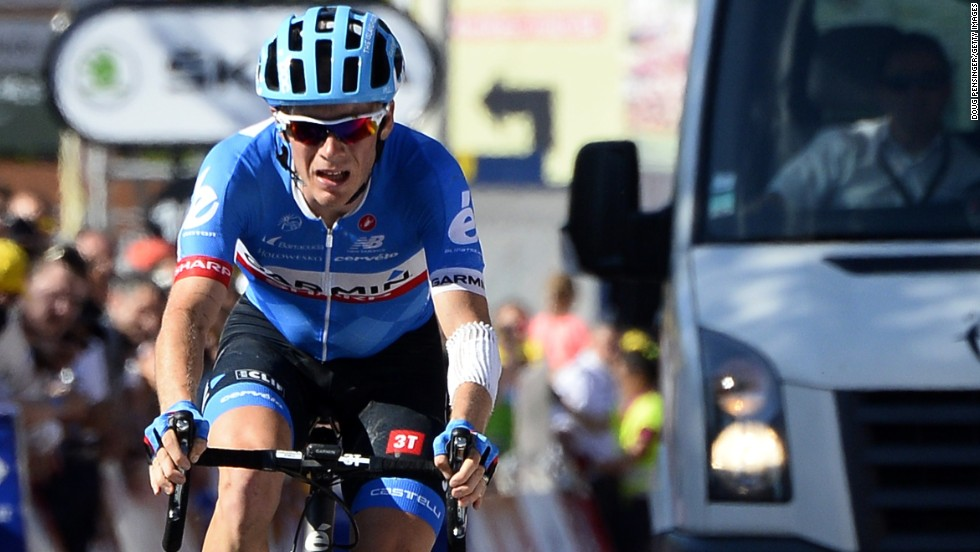 Andrew Talansky finishes the 11th stage of the Tour de France with the 'broom wagon' behind him after bravely struggling because of previous injuries.