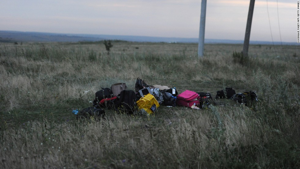 Luggage from the flight sits in a field at the crash site.