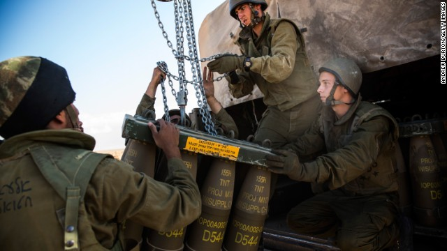 Israeli soldiers receive a new crate of artillery shells for firing into Gaza on July 17, 2014 near Sderot, Israel.