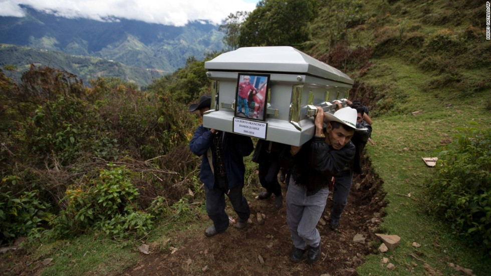 Relatives carry the coffin of 15-year-old Gilberto Francisco Ramos Juarez on Saturday, July 12, in San Jose Las Flores, Guatemala. The young Guatemalan migrant was buried in his hometown nearly a month after his decomposed body was found in the Rio Grande Valley of South Texas.