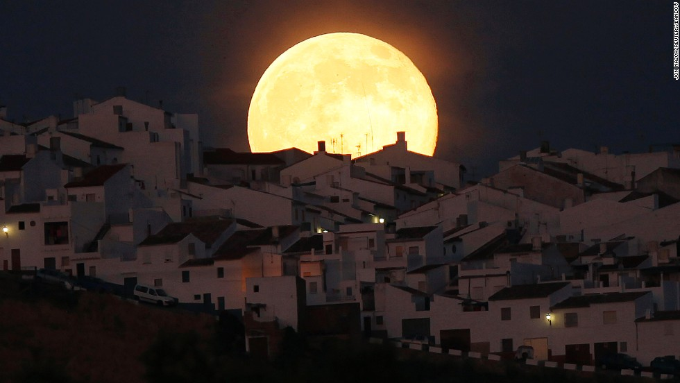 "A ""<a href=""http://www.cnn.com/2014/07/12/world/gallery/supermoon-2014/index.html"" target=""_blank"">supermoon</a>"" rises over houses in Olvera, Spain, on Saturday, July 12. The phenomenon occurs when the moon becomes full on the same day as its perigee: the point in the moon's orbit when it's closest to Earth."