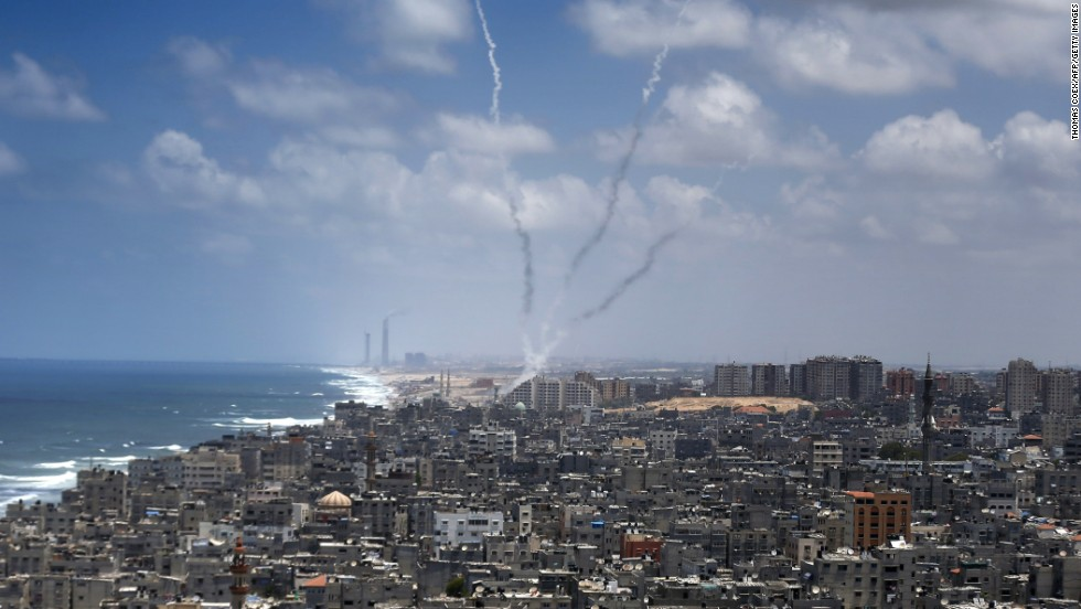 Smoke billows after rockets were launched toward Israel from Gaza City on Tuesday, July 15. People on both sides of the conflict have expressed concerns about the fate of children caught amid the Hamas rocket barrages and Israeli airstrikes.